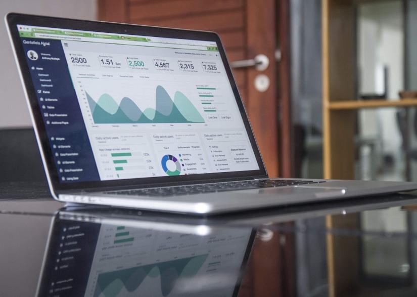 Laptop showing marketing performance graphs